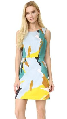 A Milly mini dress in an angular, abstract print. Hidden zip at deep V back.