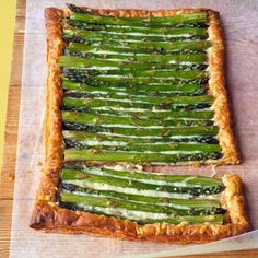 Asparagus Gruyere Tart  Roll out puff pastry dough, bake 15 minutes at 400. Sprinkle with Gruyere (or cheese of your choice) and top with Asparagus. Brush with oil, top with salt and pepper. Bake another 20-25 minutes