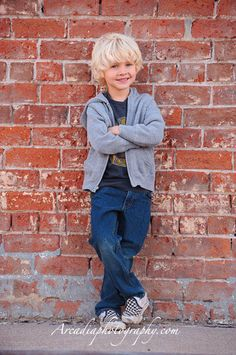 03 contemporary portrait photographers leaning brick wall
