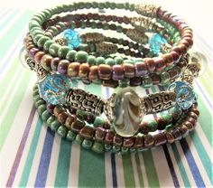 Green and Brown Spiral Memory Wrap Bracelet with Murano Glass Swirl Beads, Faceted Teal Capped Beads, Antiqued Silver Slides gBB170213 by BlingItOutLoudCharms on Etsy