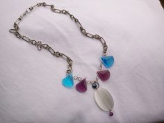 I found the white cat's eye stone at the goodwill on an old broken necklace piece, got the purple and blue stones on clearance at Michael's and I had the chain...put them all together and this is what you get!