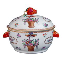 A Circular Chinese Export Famille Rose Tureen and Cover  China - LOVE this!  Circa 1765-75  The tureen and cover are decorated in fine famille rose enamels in the Meissen-stypedepicting on each side a tall wicker basket filled with fruit and flowers with a large butterfly hovering above. To each side of the baskets are large shaped panels in gold and highlighted in red containing flower bouquets.