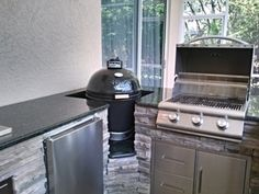 """This picture has the Blaze 25"""" 3-Burner Gas Grill, and Primo Smoker."""
