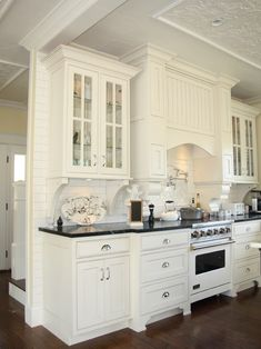 I like the black counters and the oven hood.  Don't like the glass cabinet fronts