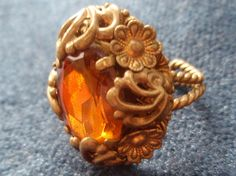 Rare Bohemian dress ring, twisted brass shank, ornate front.   Photographed by and copyright Neiger Collectors Club.