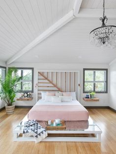 A custom-built headboard, soothing hues and distinctive design details make this open and airy master bedroom a favorite space.