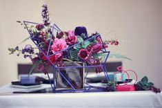 love the geometric caged centerpieces