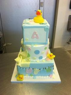 Cute as a button baby shower cake: As a decorator, Baby Shower cakes are by far my favorite party to decorate a cake for.   There is nothing more beautiful then the love of a new life.