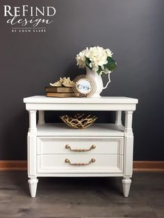 American of Martinsville Nightstand   Absolutely stunning nightstand hand painted in General Finishes Antique White, King's Gold details and hardware, with 2 beautifully lined drawers! #generalfinishes #antiquewhite #mms #furniturewax #kingsgold #gildingwax #fabriclineddrawers #hollywoodregency