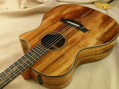 2012 Taylor Koa Series Electric Acoustic I played this at Guitar Center and the koa wood just resonated with my soul! Resonator Guitar, Archtop Guitar, Fender Guitars, Acoustic Guitars, Cool Guitar, Guitar Rack, Taylor Guitars, Guitar Collection, Guitar Design