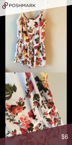 Floral Romper This is a floral romper from the brand Ambiance. It is a very thin and dainty material but still very cute! I've never worn it only taken off the tags. Ambiance Apparel Other