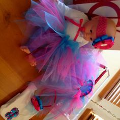Matching tutu and headband bow for little girl and her baby doll!