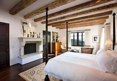 Wood beams faux exposed ceiling beams 101 how to find or fake them in beams mantle shelves made from reclaimed wood faux wood beams ouer should wood beams be painted … Metal Fireplace, Bedroom Fireplace, Bedroom Ceiling, Bedroom Decor, Decorative Fireplace, Limestone Fireplace, Stone Fireplaces, Bedroom Retreat, Exposed Ceilings