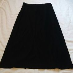 """Bebe pencil skirt EUC bebe pencil skirt black Straight style with stretch looks flares in 1st pic because there is a black slit Ribbed soft polyester spandex blend Waist to hem 26"""" Back slit 8"""" Size large fits med to small xl bebe Skirts Midi"""