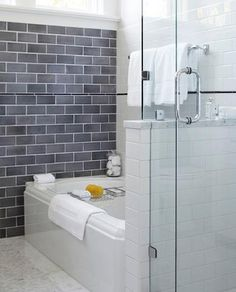 Combination Of Classic Porcelain Subway Tile And Gray Glass Tile.  Bathroom tile trends....
