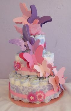 BABY GIRL , BABY SHOWER. BUTTERFLIES DIAPER CAKE. FROM LIGHT PINKS TO MAGENTA AND FROM LILAC  TO PURPLE. ADORABLE GIFT.