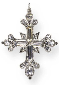 Georgian cross each arm set with a hogback-cut diamond, enhanced by pear cut diamond trefoil motif terminals, further accented by old mine-cut diamonds, mounted in silver and gold, ca. 1790.