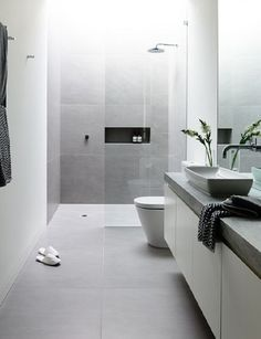 The sleekest wetroom look is achieved by matching your wall material with that of your floor, also gives the illusion of more space