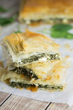 This delightful Greek spinach pie, called Spanakopita, is packed with spinach and feta cheese filling between flaky phyllo dough layers! | cookingtheglobe.com