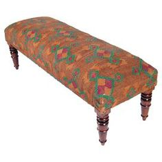 """Lend a touch of exotic appeal to your entryway or master suite with this eye-catching bench, showcasing turned legs and an upholstered seat.  Product: BenchConstruction Material: WoodColor: Brown, red and greenDimensions: 16"""" H x 48"""" W x 18"""" D"""