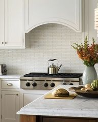 Luscious kitchens - mylusciouslife.com - simple simple curved hood, beaded and framed hood