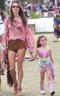 Mommy and me! Alessandra Ambrosio is getting her five-year-old daughter Anja into Coachella at an early age, as the two hit up weekend two, pictured on Saturday walking hand in hand in their boho chic finery