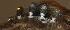 A close up from the pervious pin of the aquamarine tiara against Princess Margareit's darker hair.