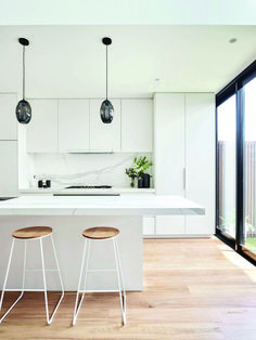 This renovated heritage cottage hides a modern interior This white kitchen features two black glass statement pendant lights over the white marble kitchen island. Pale timber flooring runs throughout. White Kitchen Interior, White Marble Kitchen, Home Decor Kitchen, Interior Design Kitchen, Modern Interior, Garage Interior, All White Kitchen, Scandinavian Interior, Marble Kitchen Ideas