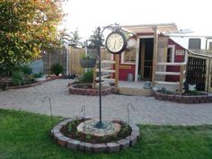The new addded clock to our backyard, banty chicken coop to the right