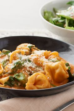 Tortellini in Creamy Rosé Sauce 1/2 cup (1/2 of 8-oz. tub) PHILADELPHIA Cream Cheese Spread 1 Tbsp. milk 1 Tbsp. olive oil 1 onion, chopped  1 clove garlic, minced 1-1/2 cups fat-free reduced-sodium chicken broth 1 cup CLASSICO FAMILY FAVORITES Traditional Pasta Sauce 1 pkg. (9 oz.) refrigerated cheese tortellini, uncooked 4 cups loosely packed baby spinach leaves  1/4 cup KRAFT Grated Parmesan Cheese