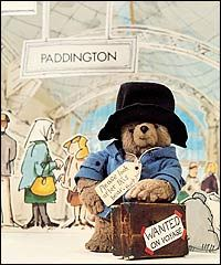 Remember having a small toy Paddington  Bear based on this version with red wellington boots
