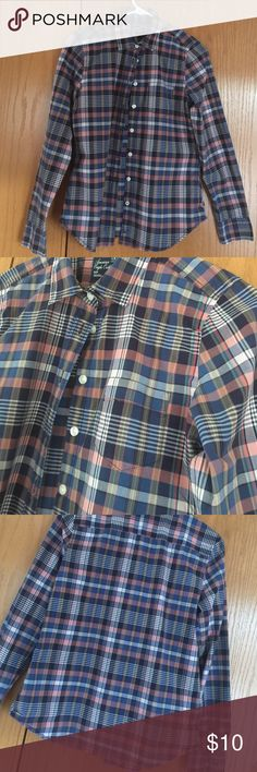 American Eagle Outfitters plaid shirt. Great plaid shirt with so many possibilities. Pair with jeans.  Wear with a business suit.  Layer under a sweater with shirt tails hanging out!   Excellent condition. Button cuffs.  Left breast pocket.  Navy with peach, white, tan. American Eagle Outfitters Tops Blouses