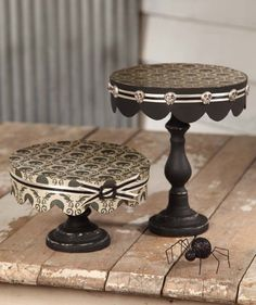 Dollar store candlesticks painted, glue on cake/foam board, cover with paper or fabric, finish with ribbon.......great for varying heights on buffet