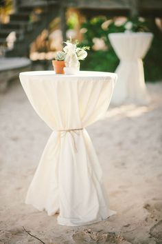 New 90 in white polyester tablecloths. They will go half way to the floor with a 72 in round table, and will touch the floor for cocktail sized (30 in) tables. Classic staple for any themed wedding or party.