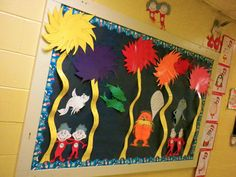 My March Bulletin Board in honor of Dr. Seuss.  I drew the truffula trees, the Lorax, and the fish myself.  The Thing 1 & 2s were made by my students.