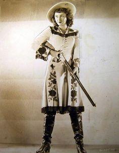 Barbara Stanwyck as Annie Oakley