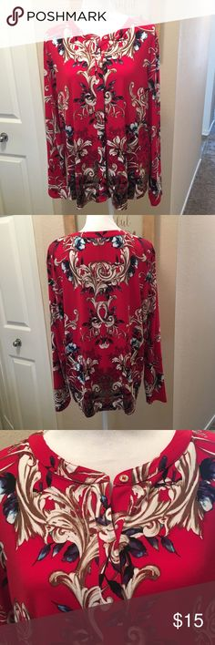 Red floral blouse Red floral blouse by Dana Bachman. Buttons along front. Pretty floral pattern. In nearly new condition! Dana Buchman Tops