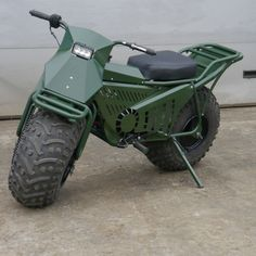 You don't need us to tell you how much fun it is to go off-road in an ATV. But the Tarus Motorcycle raises the off-road stakes even higher. This ATV disguised as a motorcycle is capable of slicing through. Mini Bike, Mini Motorbike, Motorcycle Camping, Camping Gear, Scrambler Motorcycle, Motor Scooters, Car Wheels, Go Kart, Custom Bikes