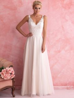 2802 Allure Romance Bridal Gown - We drew inspiration from the ballet for this ethereal A-line bridal gown. Lace and soft tulle pair perfectly with the simple design.