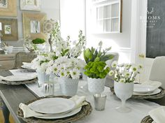 Create a simple, neutral tablescape for spring with grapevine chargers and milk glass filled with daisies like this one from Rooms for Rent   Friday Favorites at www.andersonandgrant.com