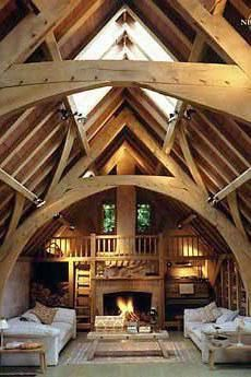 I love the loft wood built on bookcases and central hearth. Too grand for me Viking House, Oak Framed Buildings, Oak Frame House, Timber Architecture, Converted Barn, Timber Frame Homes, Log Homes, Design Case, Future House