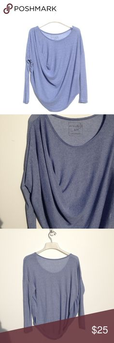 Periwinkle Thin Free People Sweater Periwinkle slouchy sweater with a extra section of scrunch on one side. Not very thick, pretty lightweight. Only flaw is a small pull as shown in the fourth image. New without tags. Free People Sweaters