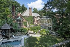 Dramatic staircases, nine fireplaces and a 20-car driveway are among the features.