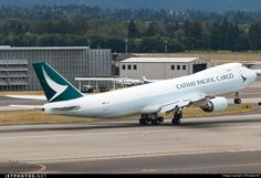 A freshly-painted Cathay Pacific Cargo 747-8F freighter returning to Seattle - by Russel Hill