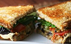 In this recipe, grilled eggplant, marinated tomatoes, hummus, and kalamata olives are pressed between two slices of toasted homemade bread—what's not to love?