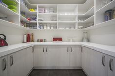 Huge scullery!  Lots of storage and bench space.