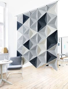 5 Inspiring Ideas For How You Can Use Room Dividers In Your Home Home Decorating Ideas Space dividers are not just for bedrooms anymore. From bedrooms to dens to closets, spaces in between are wide open and ready for the installation of . Acustic Panels, Espace Design, Acoustic Wall Panels, Acoustic Design, Space Dividers, Lofts, Office Interiors, Interior Design Living Room, Interior Paint