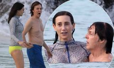 Paul McCartney frolics in the surf with Nancy Shevell during holiday