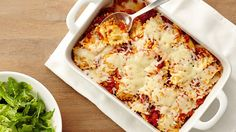 Almost like an instant lasagna, this clever recipe uses frozen ravioli in an easy casserole with cheese, sauce, and basil.