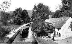 Llangollen, The Canal c.1935. Long before the holiday boat industry took off, a trip behind a horse-drawn boat in Llangollen was a popular outing. The boats are towed to the end of the cruise and then both horse and rudder are moved to the opposite end for the return trip, thus solving the problem created by the lack of turning space. #Canals